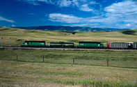 Burlington Northern Dash 2's numbers 7248 & 7279 along with fuel tender BN FT 30 pushing a loaded coal train up Parkman Hill at the Montana/ Wyoming border on Bighorn Subdivision on old CB&Q trackage
