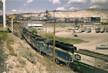 Six BN GP20's Pull Interchange Train Toward GN Butte Yard - July 1970