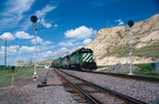Burlington Northern leads an eastbound freight through Snowden with SD40 - 2 No. 6819 West of  Williston, North Dakota