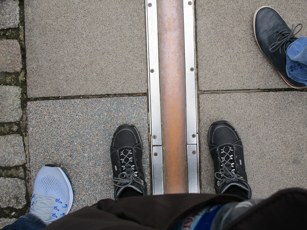 Me standing on both sides of the world at the prime meridian