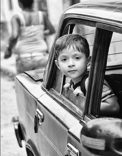 Boy In A Car