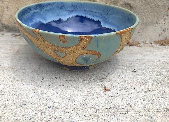 glossy blue with undulating iceberg rim