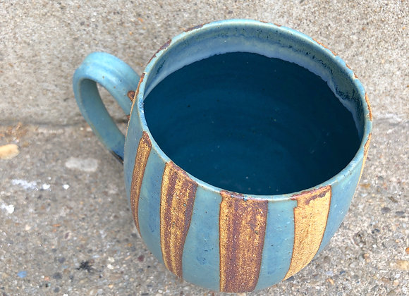 Striped blue stoneware cup