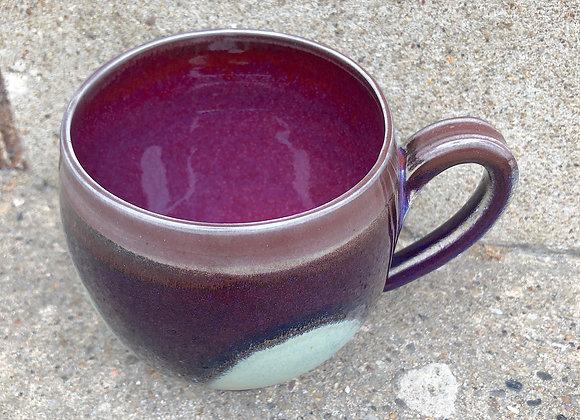 fat copper red cup with a matte aqua dot