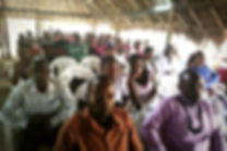 Kilifi chuch members listening to the word delivered by Reverend Zephania