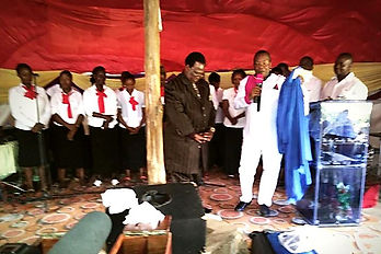 John at Kilifi church receives choir robe and dediates the service to the Lord