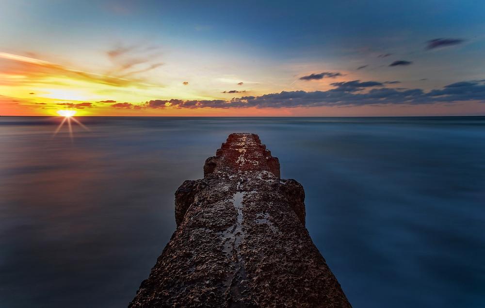 Tel Aviv beach sunset; photo credit Zoltan Tasi