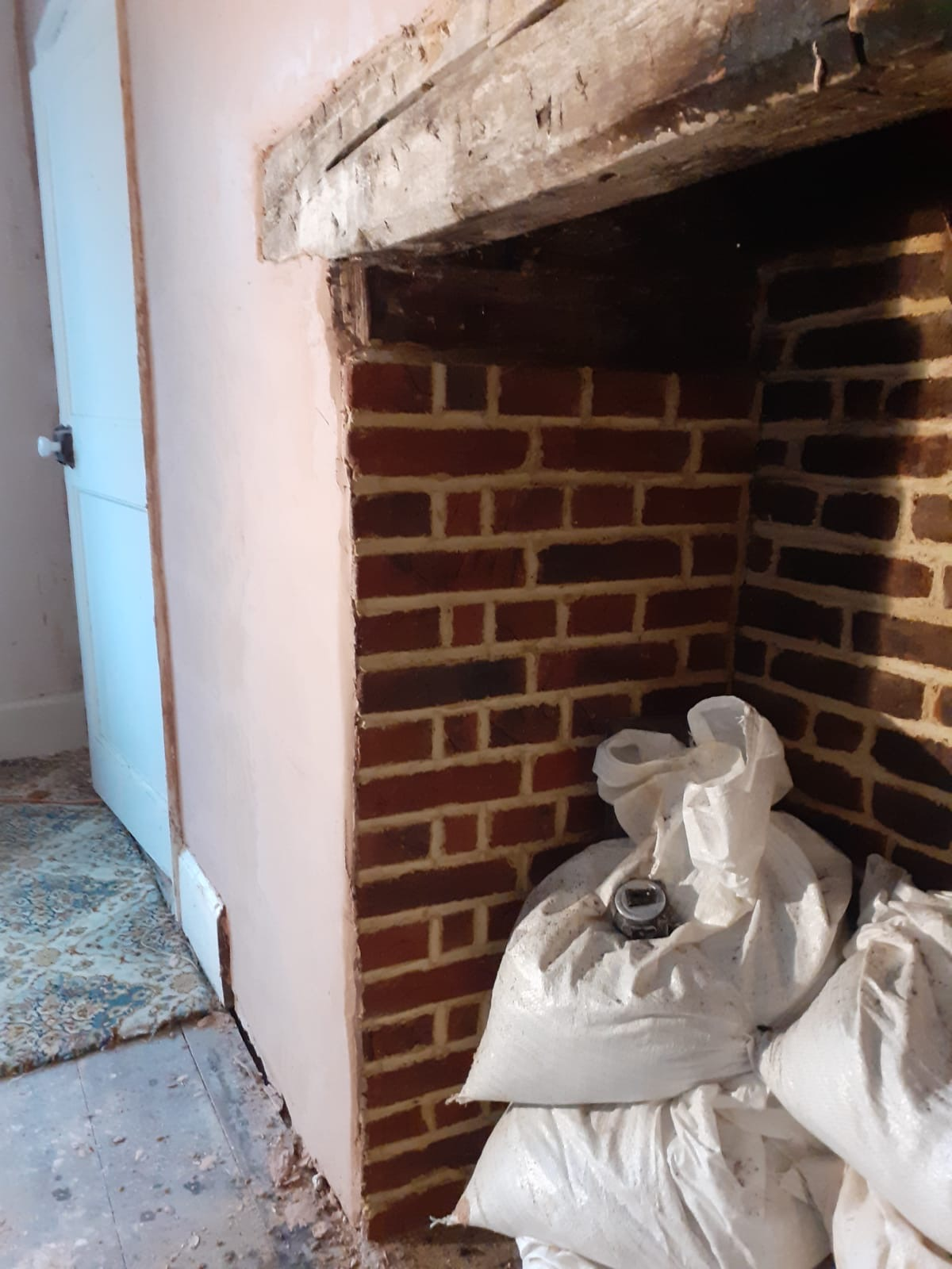 Brick slip tiles stuck in fireplace