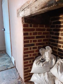 Brick slip tiles stuck in fireplace