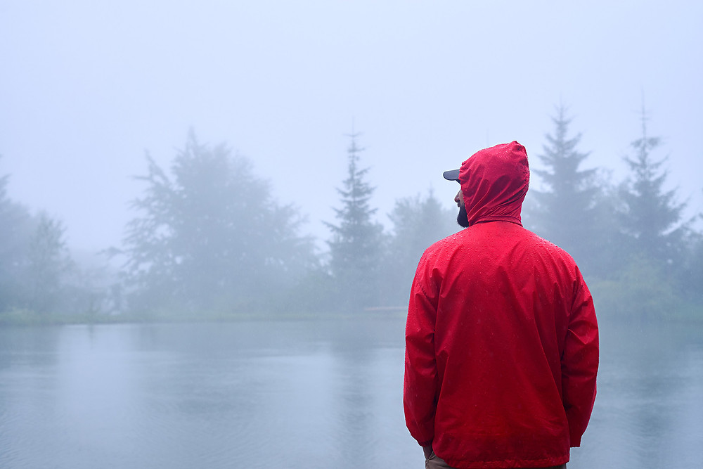 man standing at the lake