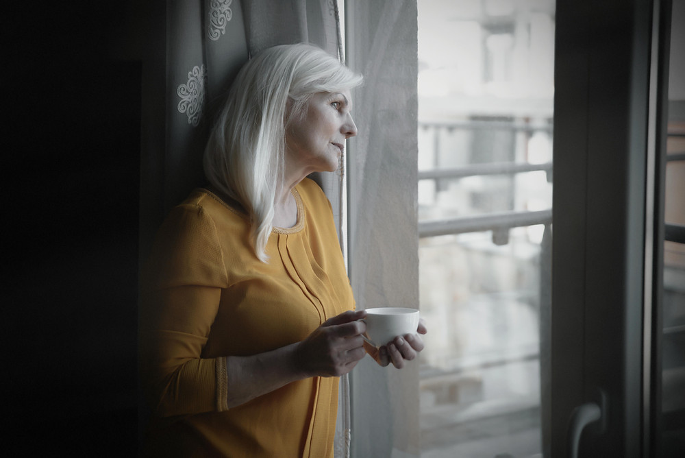 Unhappy woman looking out of the window