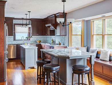 Picture of a remodeled kitchen with dark brown cabinets, island and backsplash