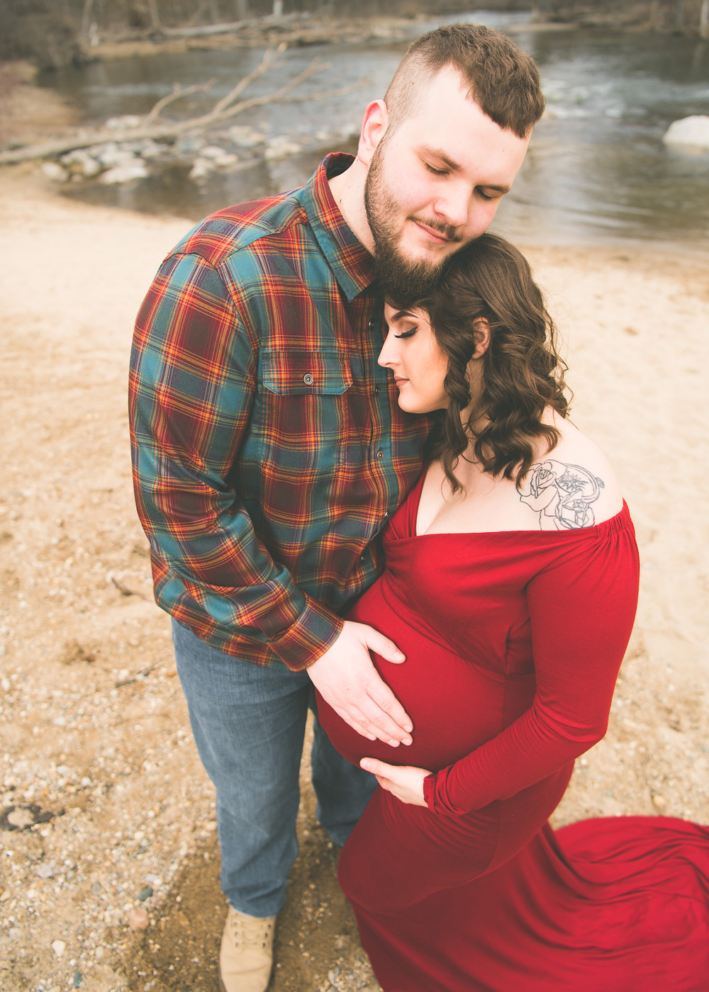 red maternity dress with husband