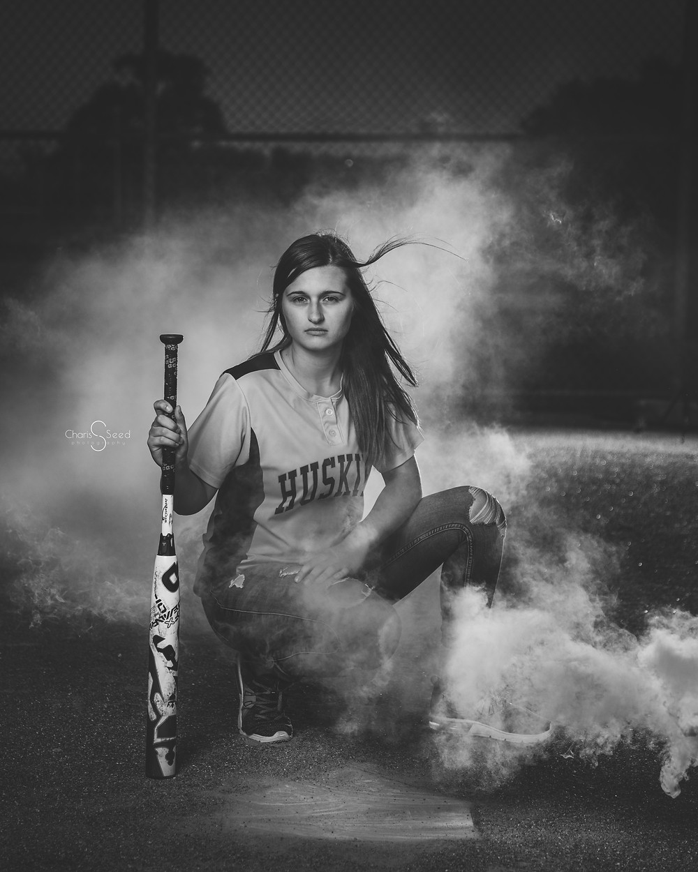 black and white softball pic with smoke bomb