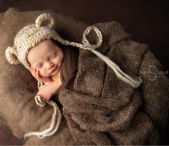 baby sleeping with teddy bear hat