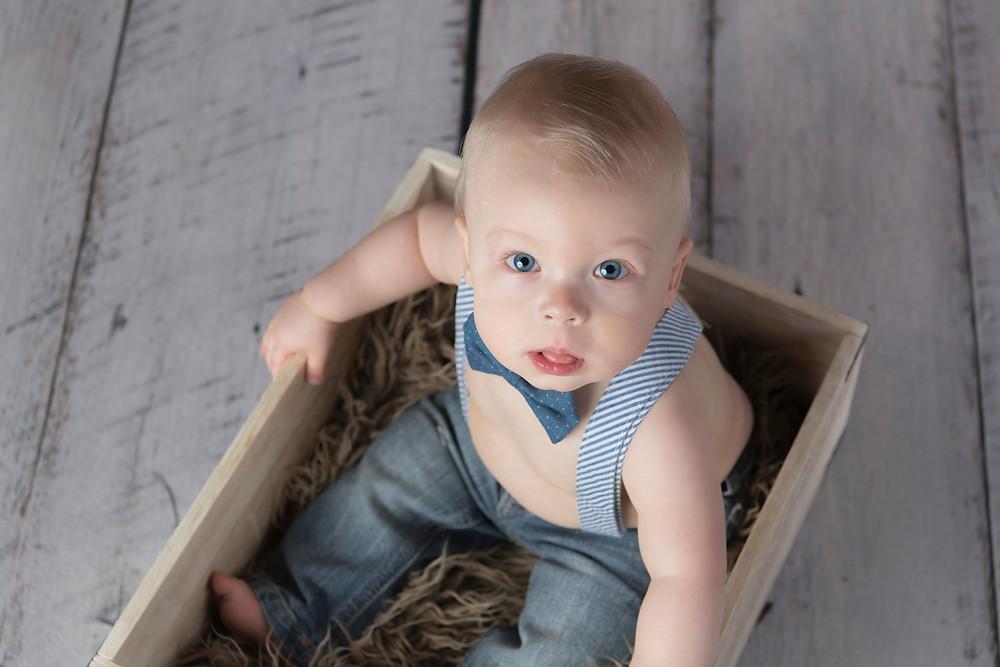 little blond boy with blue bowtie
