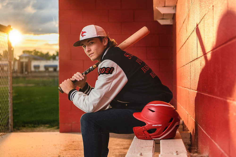 Senior pictures dugout baseball