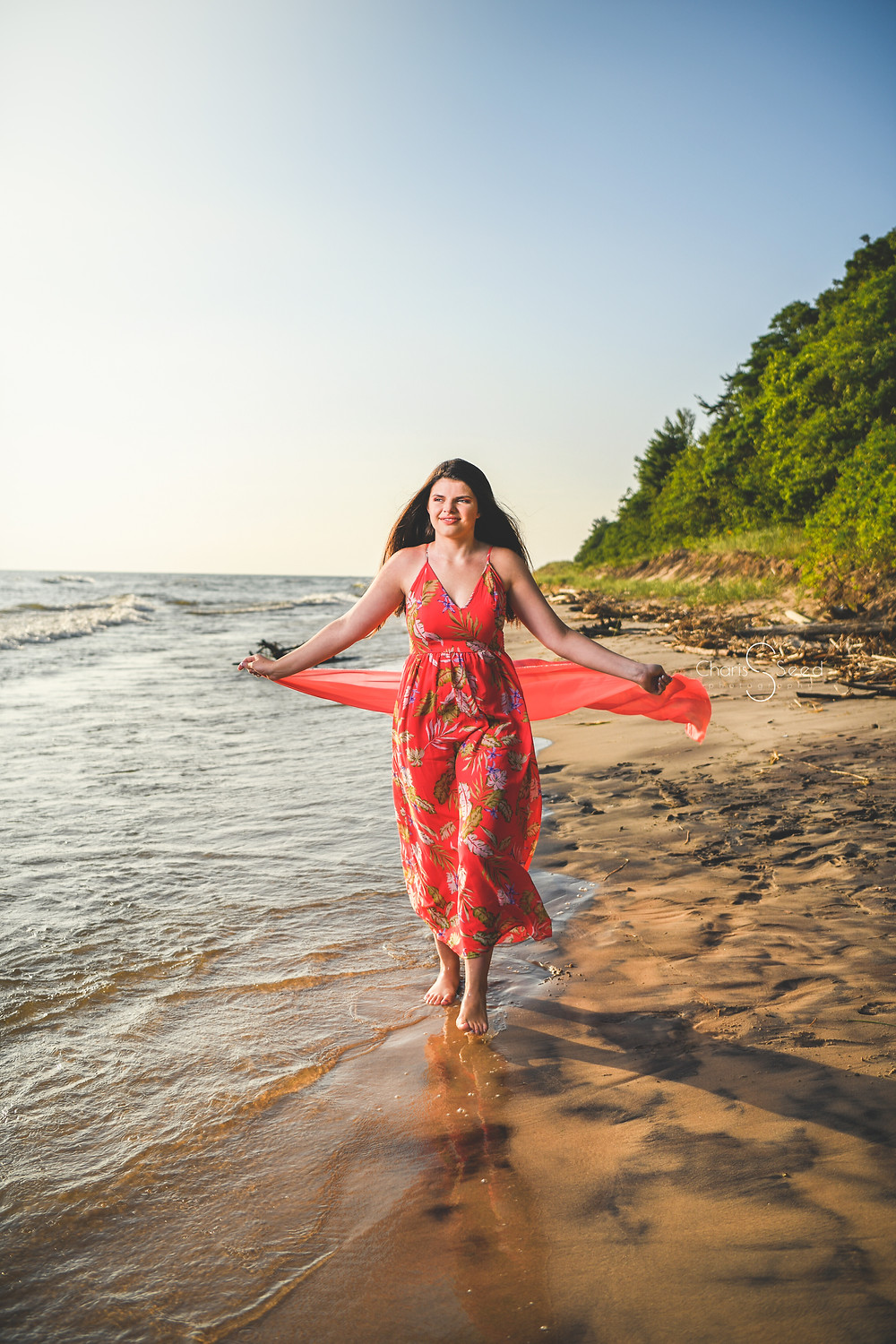 senior girl walking on the beach