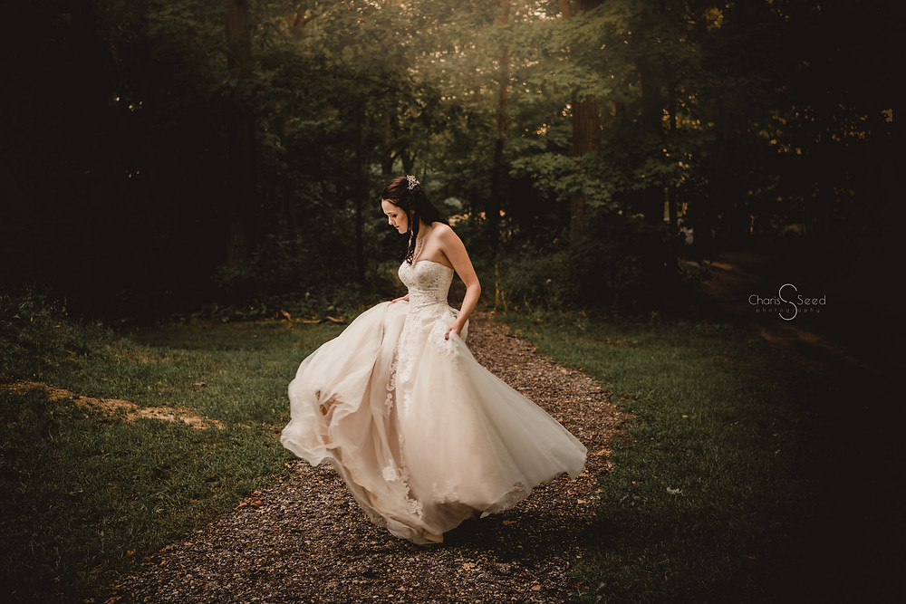bride dancing alone with dress swirling