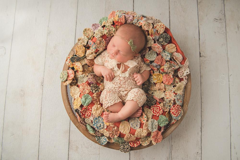 newborn baby in bowl