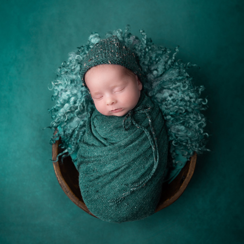 Emerald green baby in bowl