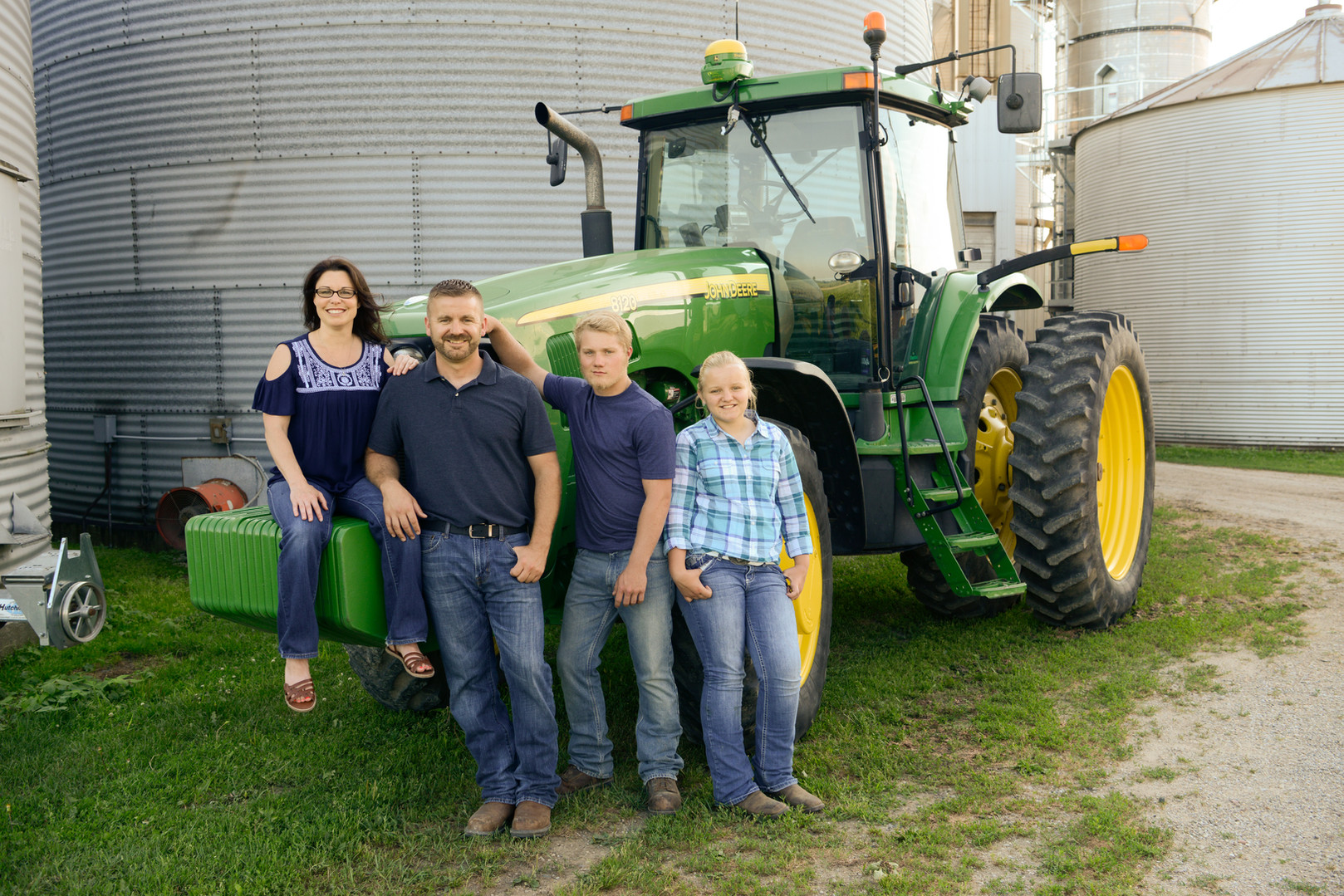 farm family picture on tractor