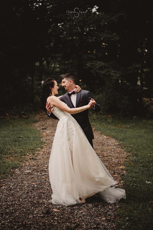 wedding photographer bride and groom dip