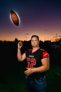 Senior pictures toss football