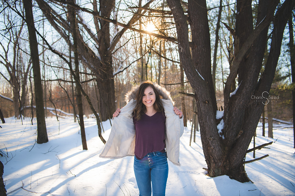 senior picture in winter forest