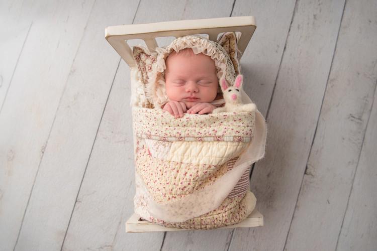 newborn in tiny bed
