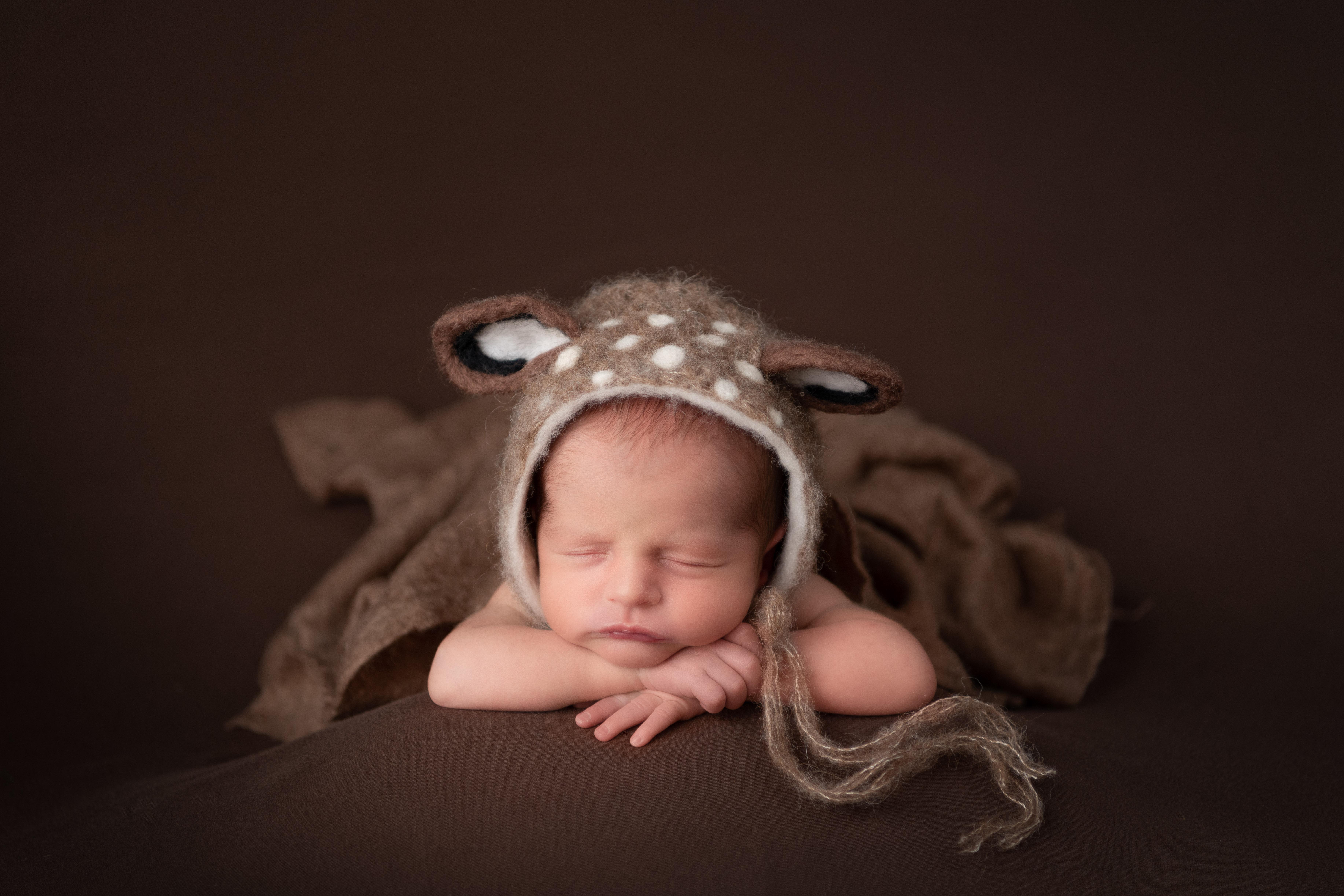 newborn baby in deer bonnet