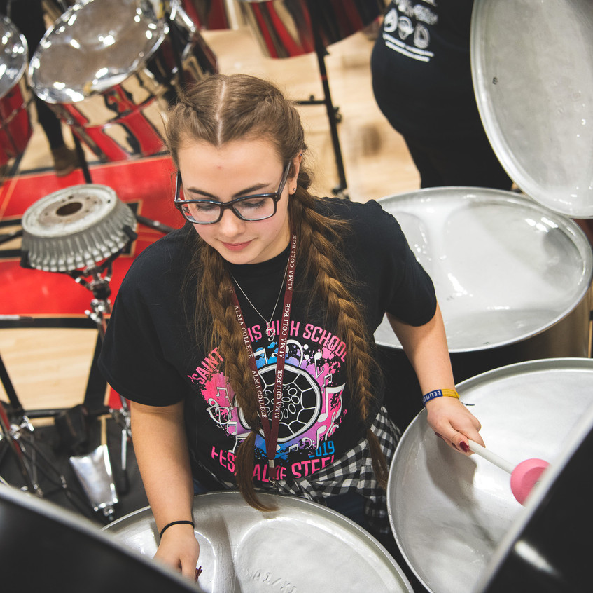 girl playing steel drums