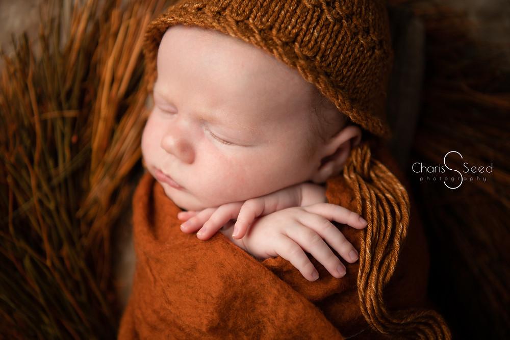 close up of newborn face sleeping