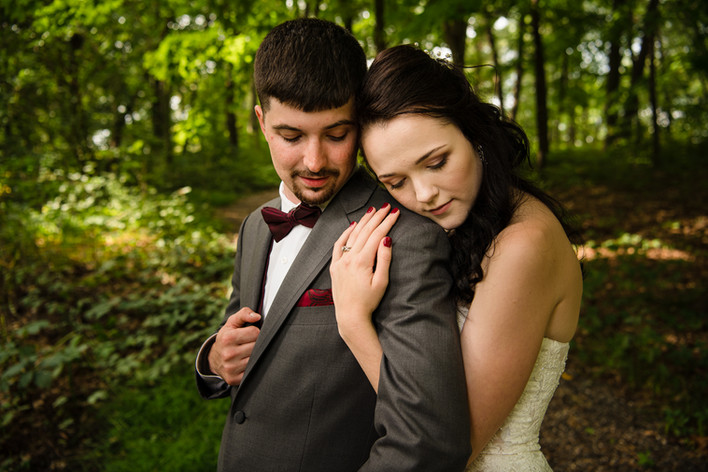 bride and groom on shoulder