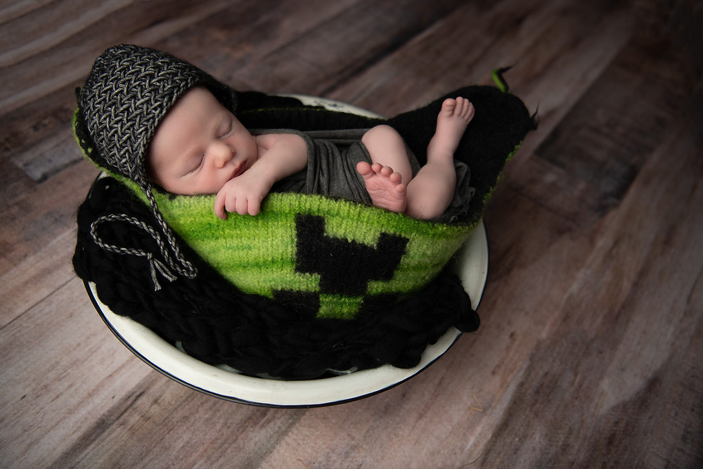 baby sleeping in hat knit by mom