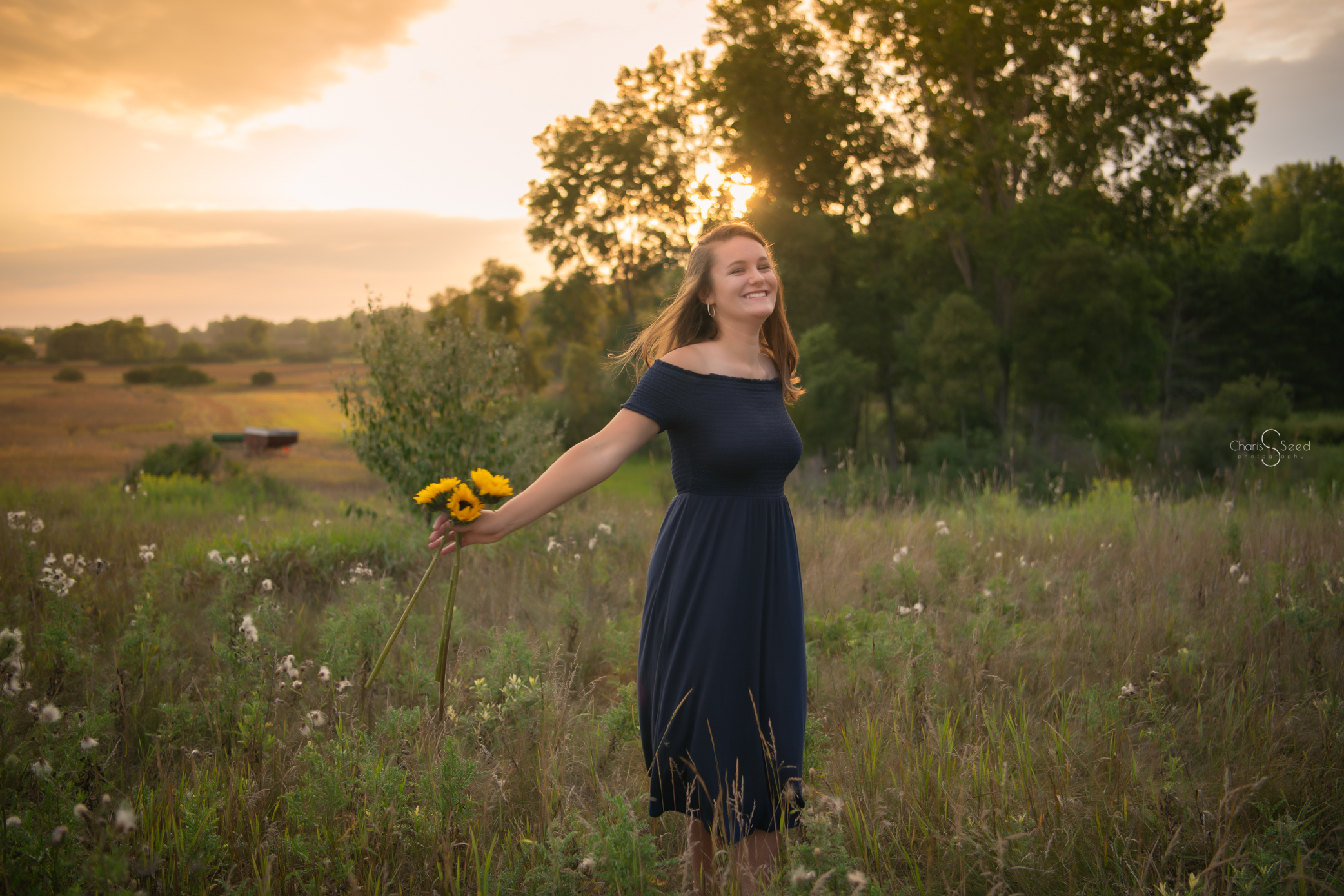 dancing in field with sunflowers