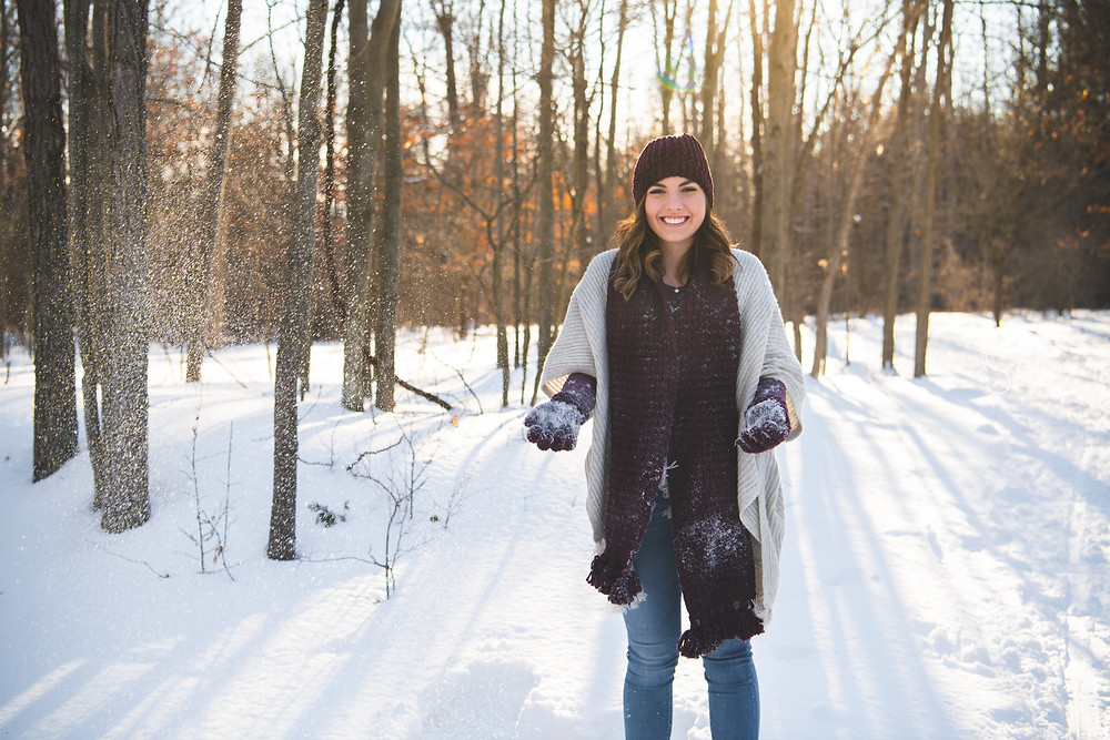 senior pic throwing snow
