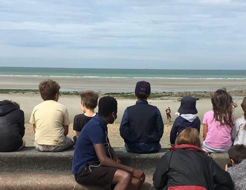 young people facing the sea