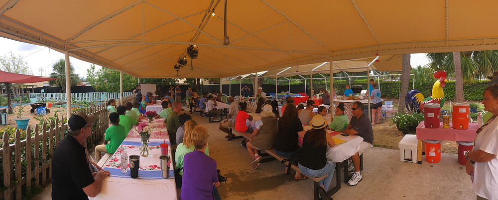 Lots of families in the EDU-Garden pavilion at EDU-Garden Day