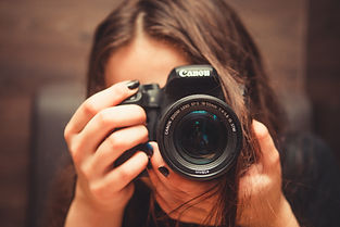 woman holding a camera to her eye.jpg
