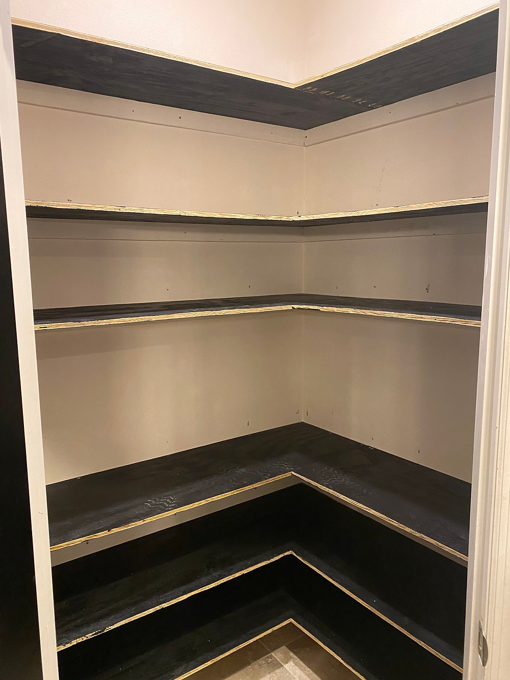 Unfinished shelves in place