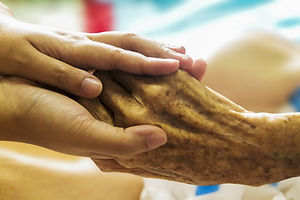 Canva - Holding an Elderly Hand with Car