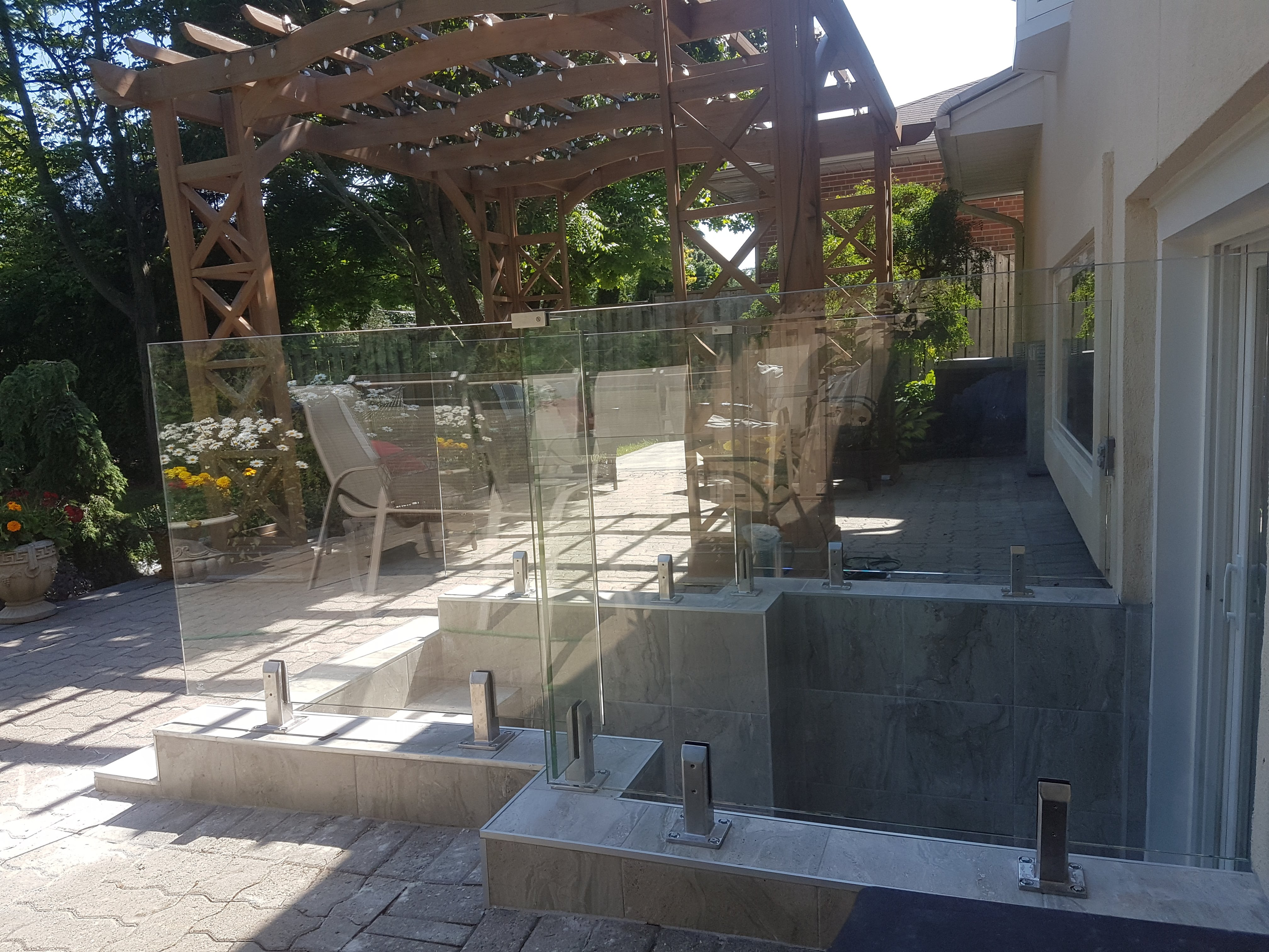Frameless glass and stainless steel