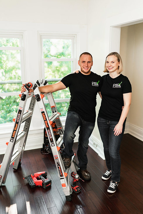 Jesse Handyman and his wife Anne next to a ladder and tools