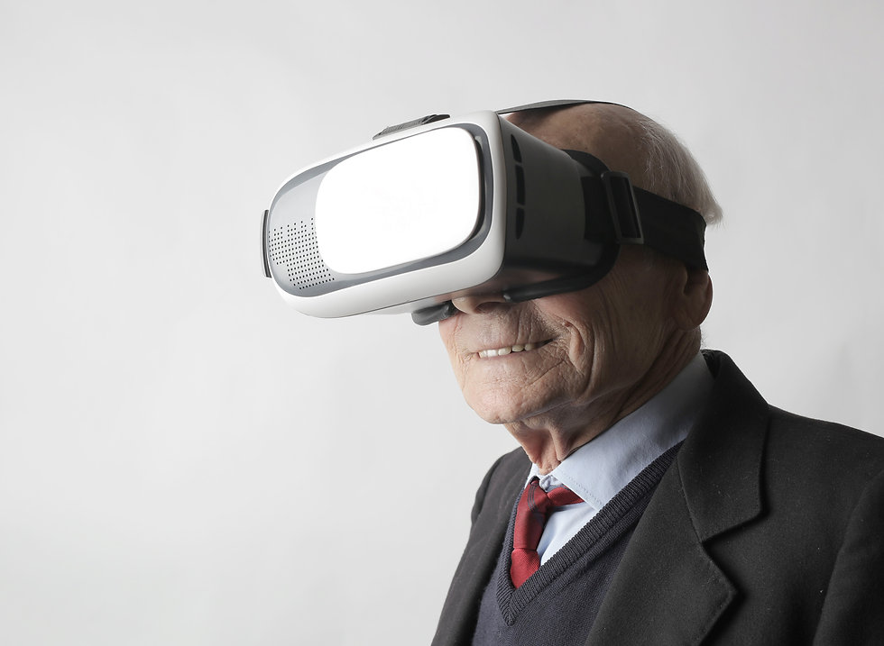 senior-man-using-vr-goggles-in-studio-38