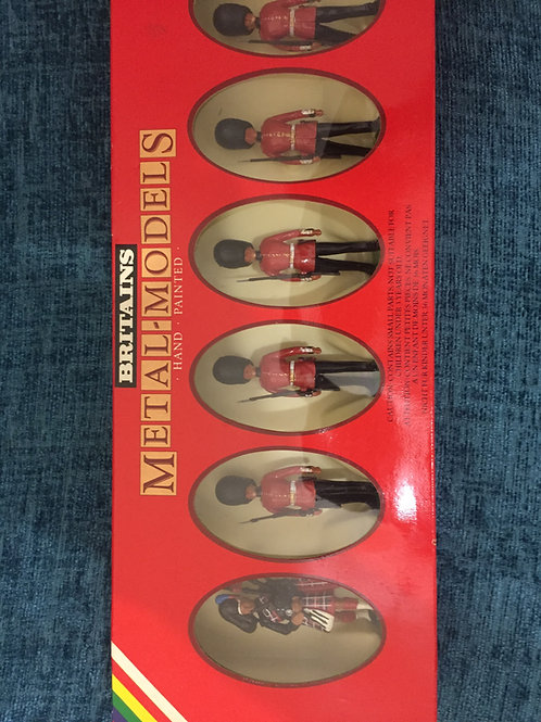 Britains Set 7238Scots Guards piper and 5 Marching First Version Guardsman