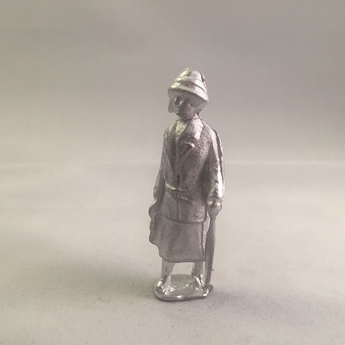 B59. Lady walking with brolly.