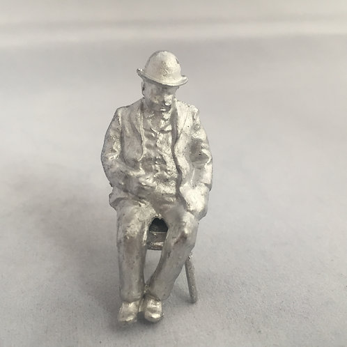 B85. Seated Gent in bowler