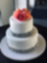 WEDDING CAKE FLOWERS ON TOP.jpg