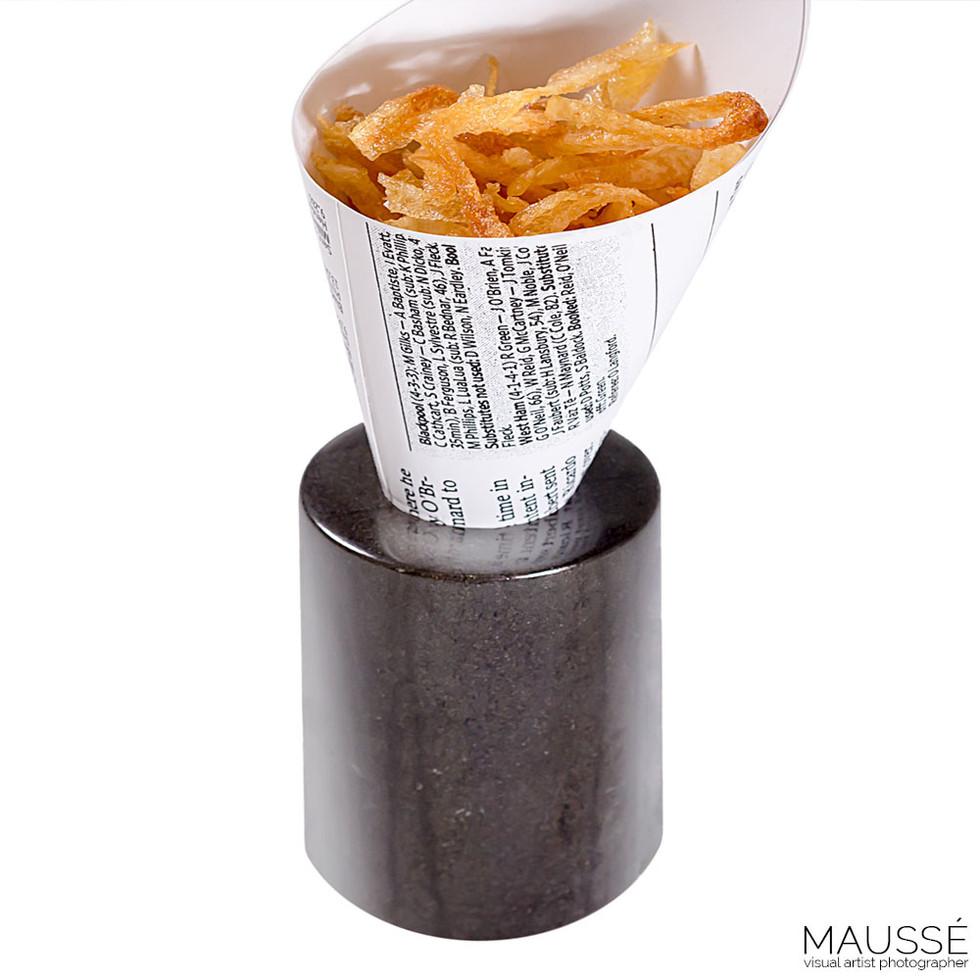 Rizos de patatas fritas.